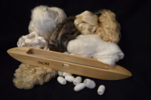 Silk fibre and shuttle